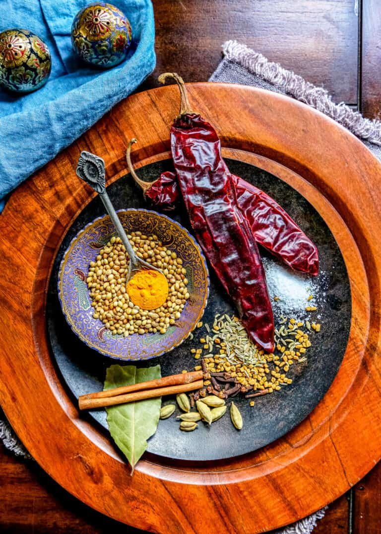 whole spices and dried chili peppers to make a chana masala spice recipe