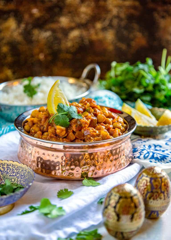 copper serving dish full of chana masala