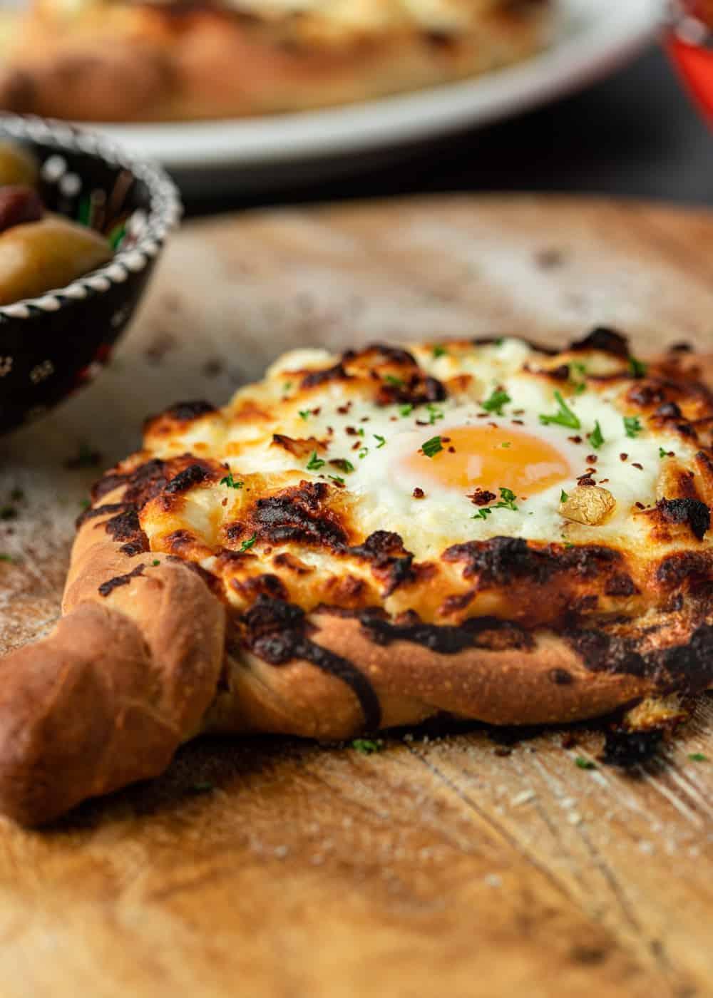 Georgian cheese bread on wood serving board