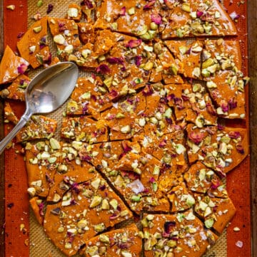persian candy pistachio brittle broken into pieces on silicone pastry mat