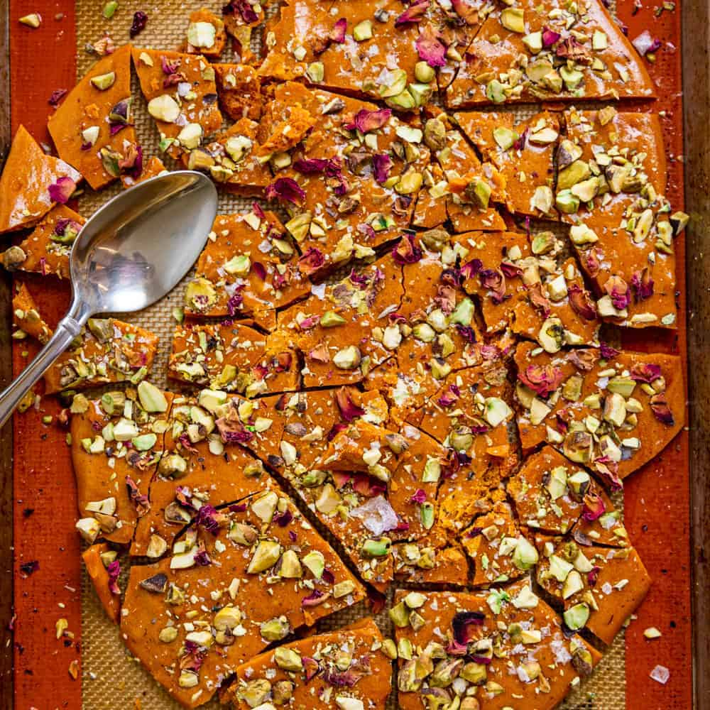 broken pieces of homemade pistachio brittle on silicone baking mat