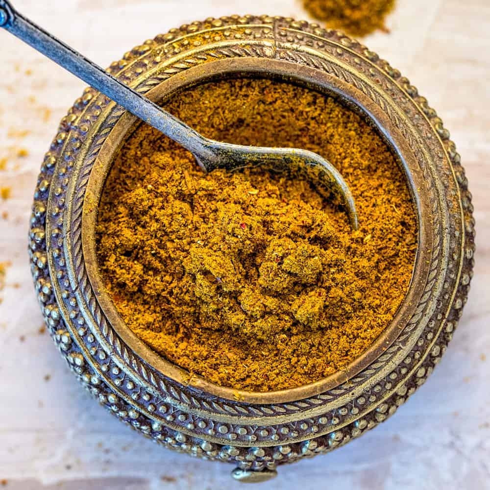 spoon in a bowl of homemade moroccan spice blend