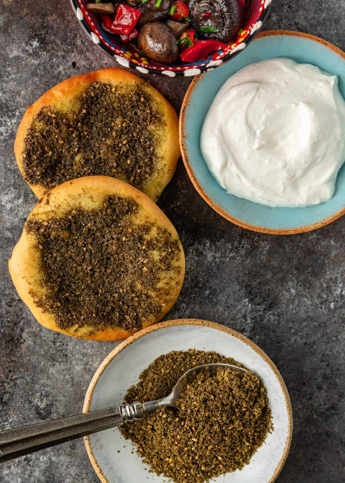 overhead image: manakeesh with zaatar and labneh