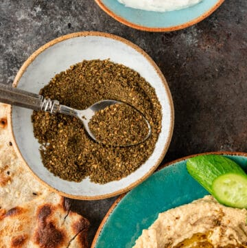 Lebanese za'atar spice blend with spoon in white dish