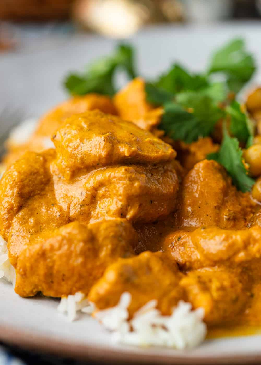 close up of creamy butter chicken on a bed of white rice