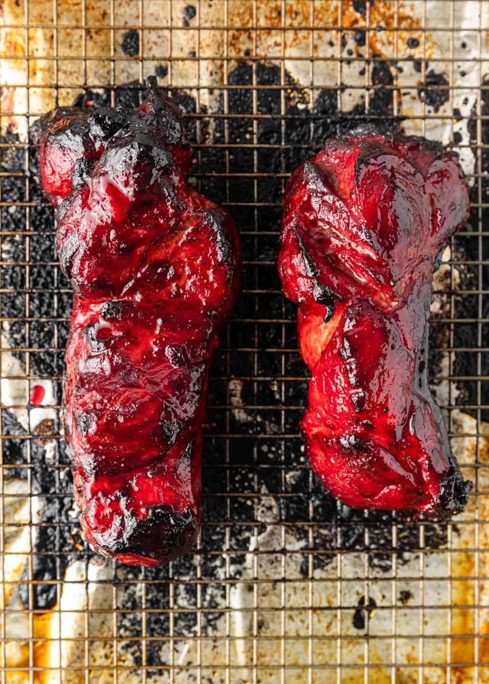 2 Chinese Barbecue Pork strips on baking sheet glazed