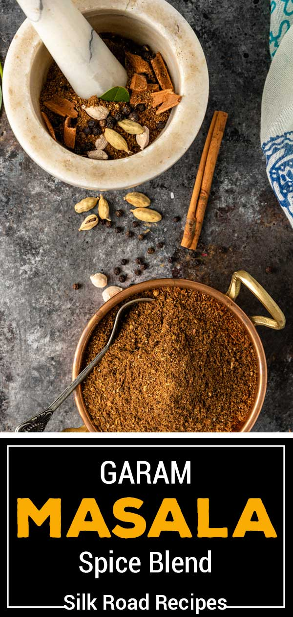 image of whole spices in a mortar and pestle and ground seasoning in a small bowl titled Garam Masala Spice Blend Silk Road Recipes