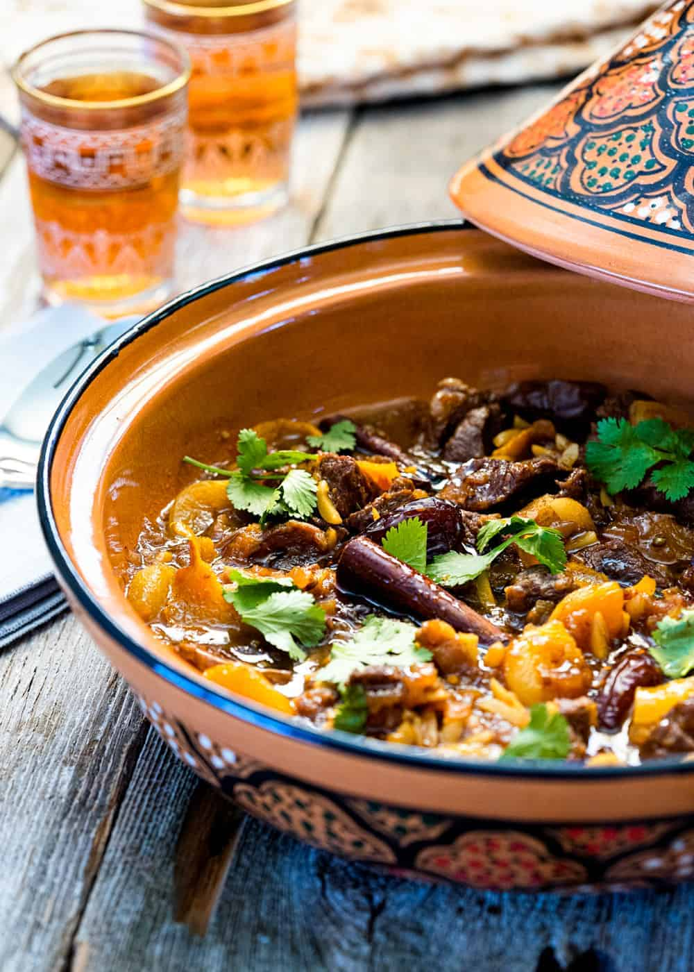 Moroccan lamb dinner with apricots and dates in large clay pot