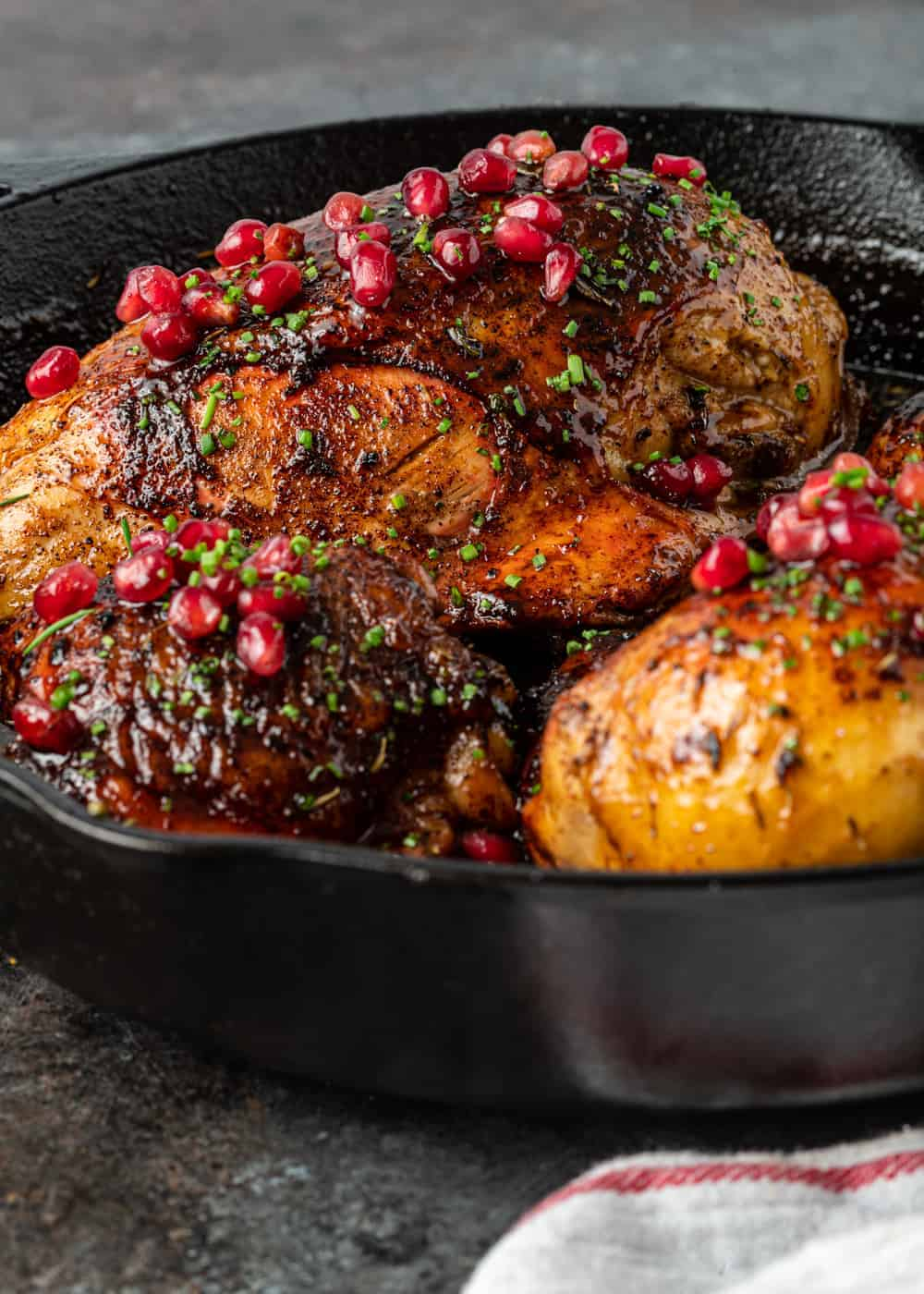 Jordanian chicken with pomegranate sauce in cast iron skillet