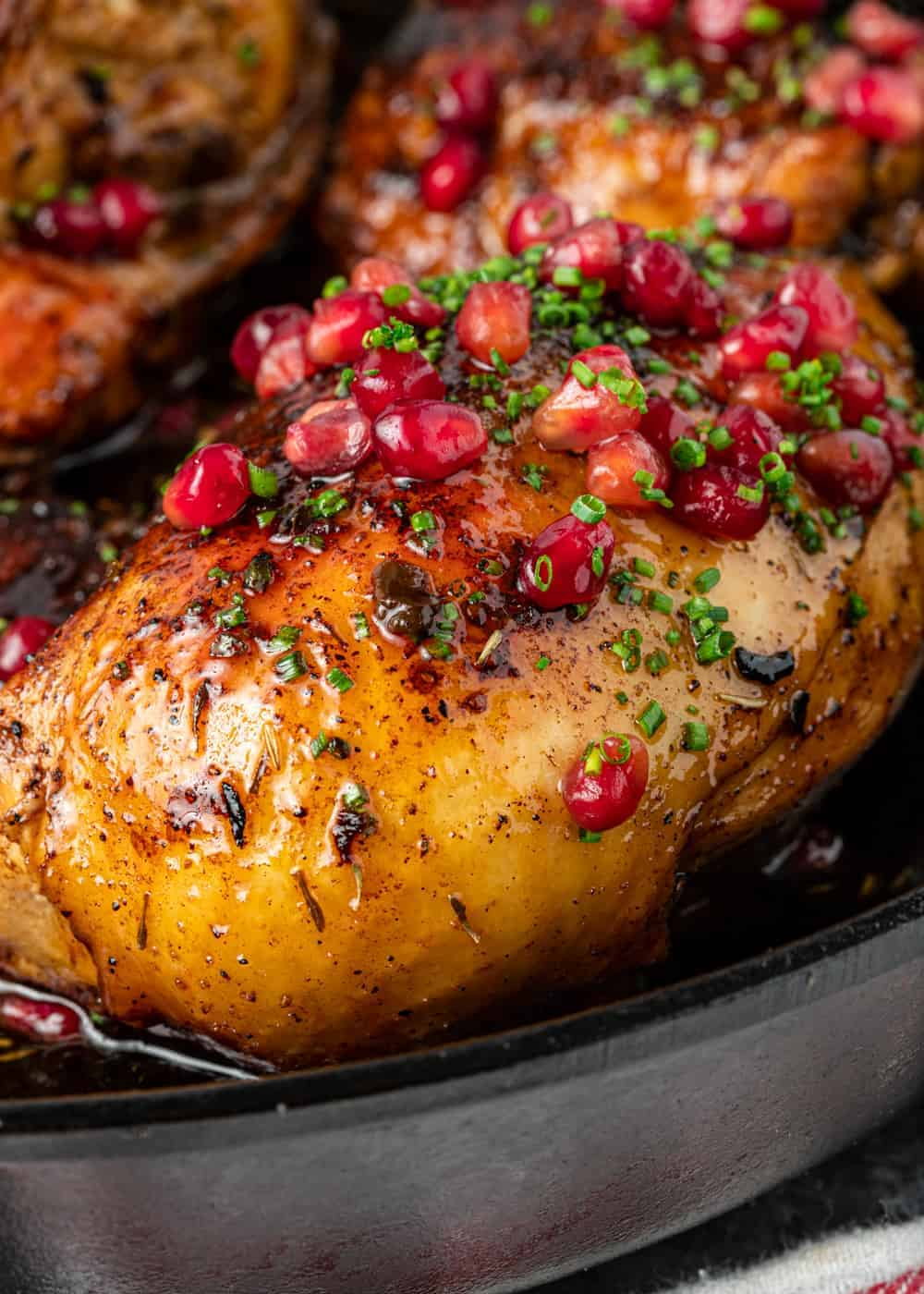 Jordanian pan-roasted chicken breast topped with pomegranate molasses sauce