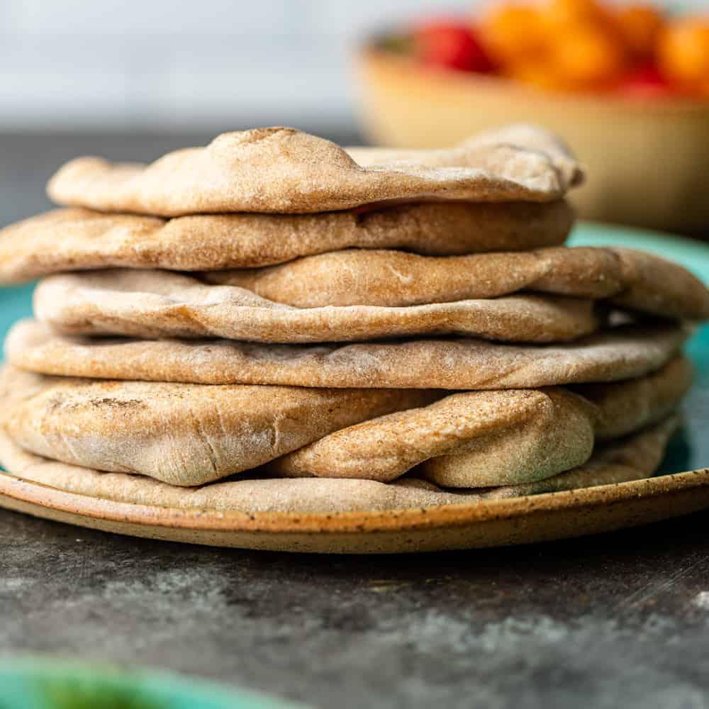 stack of wheat pita bread on ceramic plate