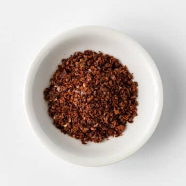 aleppo pepper in small white bowl