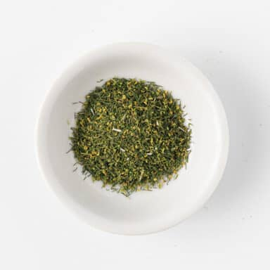 dried dill in small white bowl