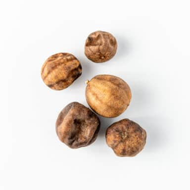 dried limes on white table top