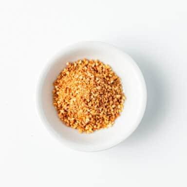 diced dried orange peel on white table top