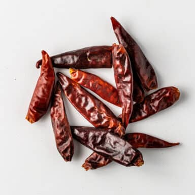 dried red chiles on white board