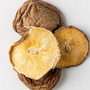 dried shitake mushrooms on white tabletop