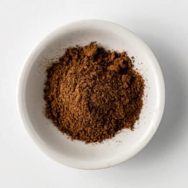 five spice powder in small white bowl