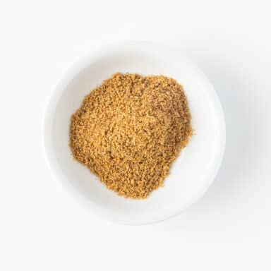 ground cumin in small white bowl