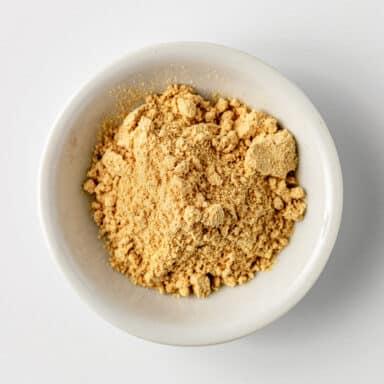 ground ginger powder in white bowl