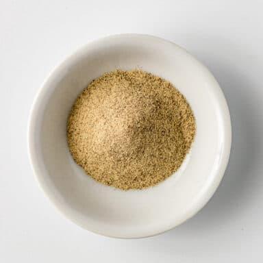 ground white pepper in small white bowl