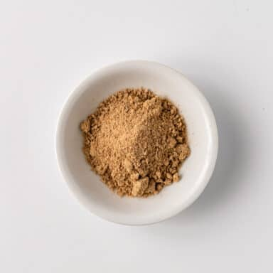 mango powder in small white bowl