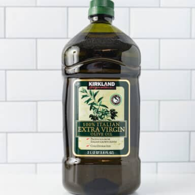 jug of olive oil on white table top