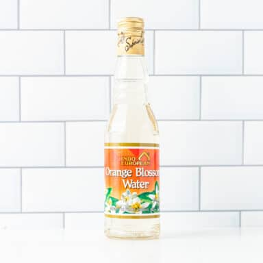 orange water bottle on white table top