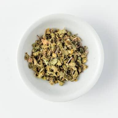 dried oregano in small white bowl