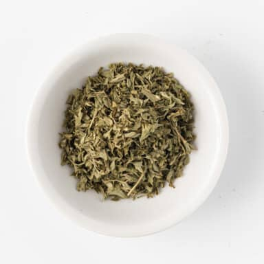 dried parsley in small white bowl
