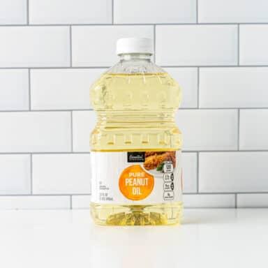 quart of peanut oil on white tabletop