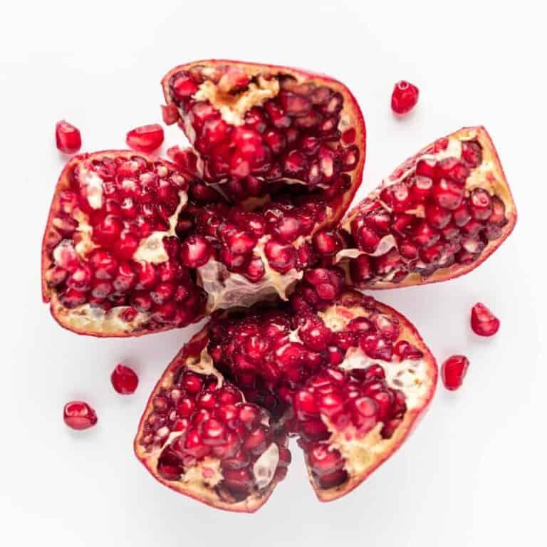 pomegranate split open exposing arils