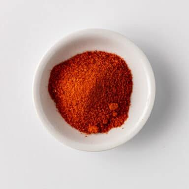 red chili powder in small white bowl