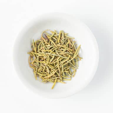dried rosemary in small white bowl