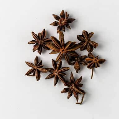 whole star anise spice on white background