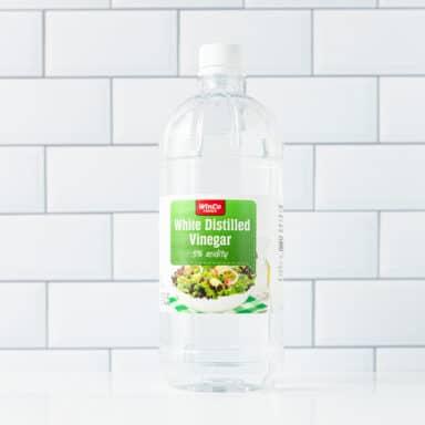 bottle of white vinegar on whit etable top