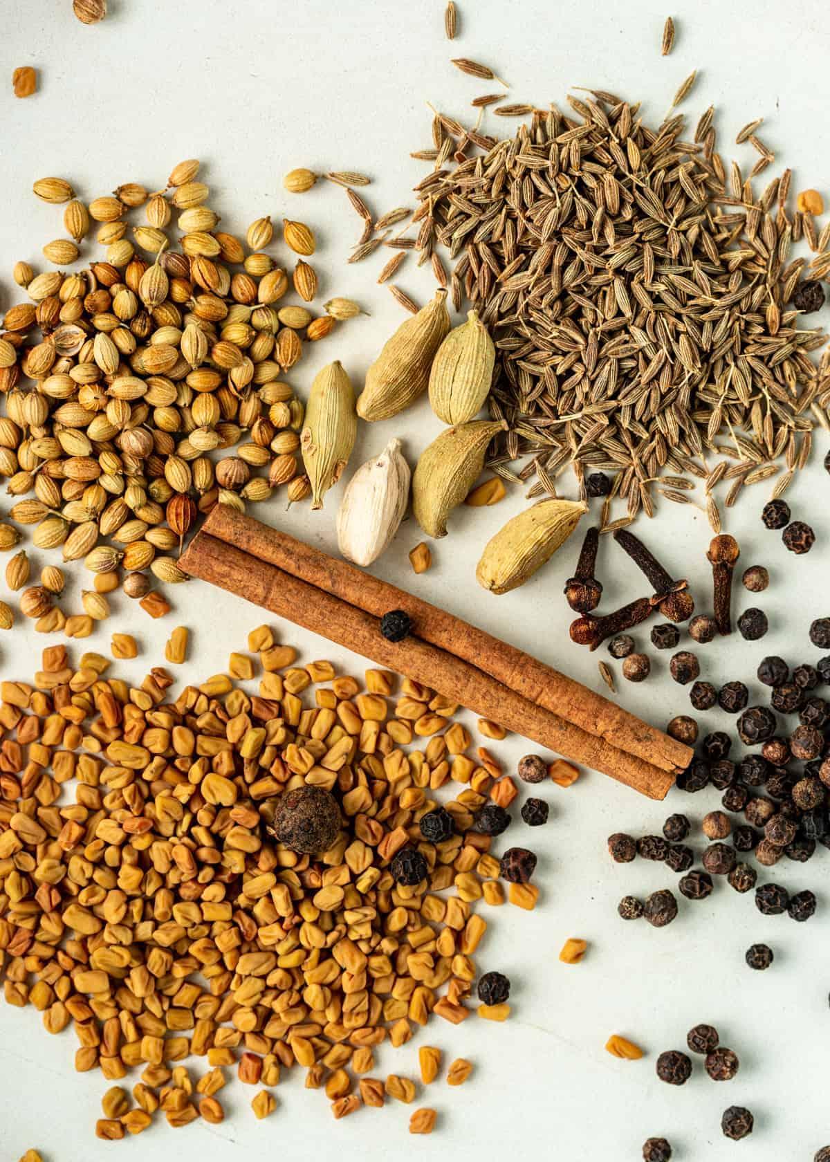 fresh cloves, cinnamon sticks, fenugreek and other ingredients to make Ethiopian seasoning blend