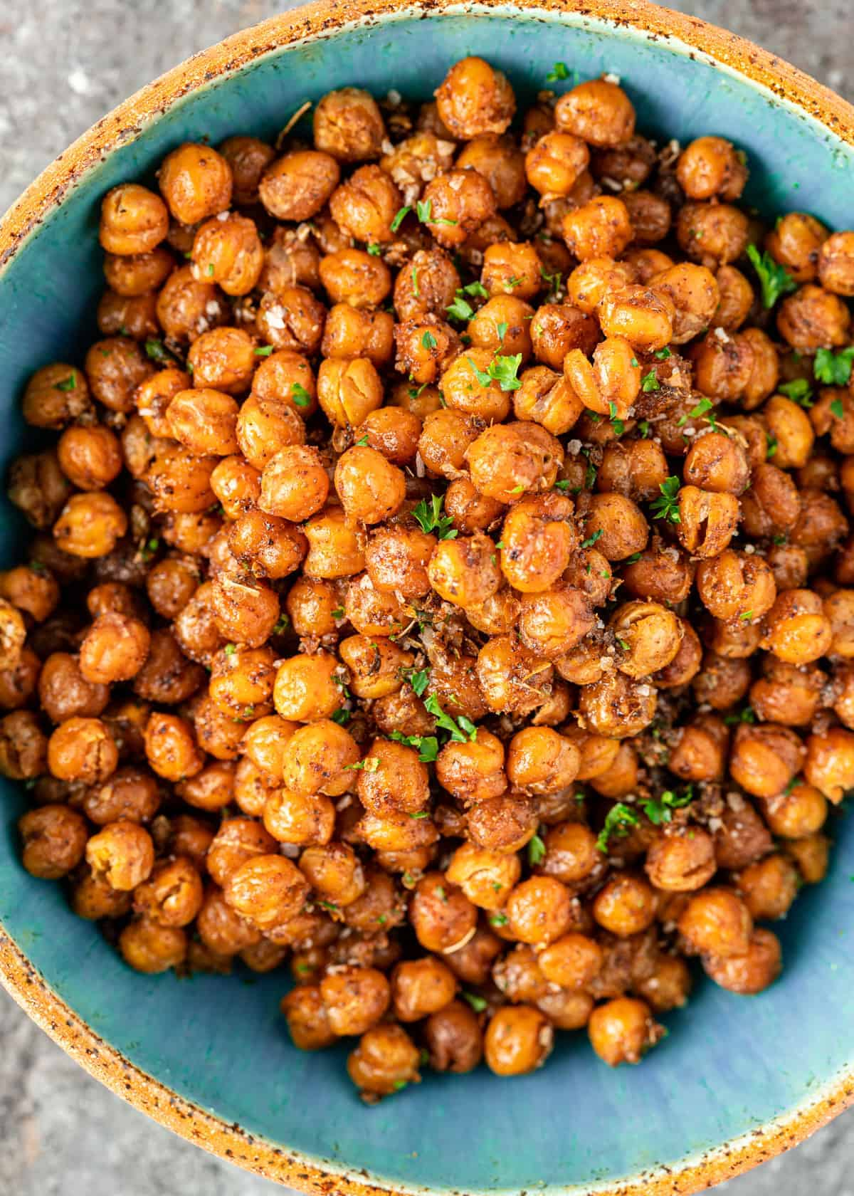 overhead image of turkish sweet roasted chickpeas in a blue bowl.