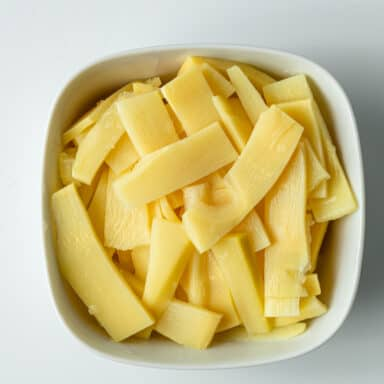sliced bamboo shoots in small white bowl
