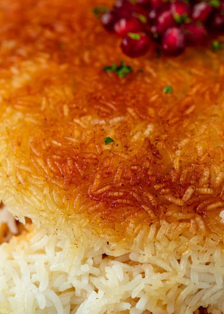 close up image of crispy golden brown grains of rice cooked onto a fluffy rice layer beneath it