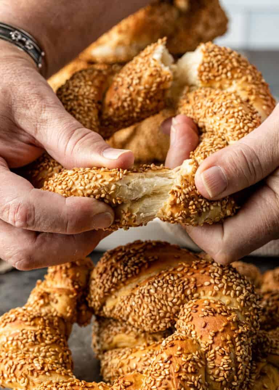 Sesame Bread Rings being pulled apart