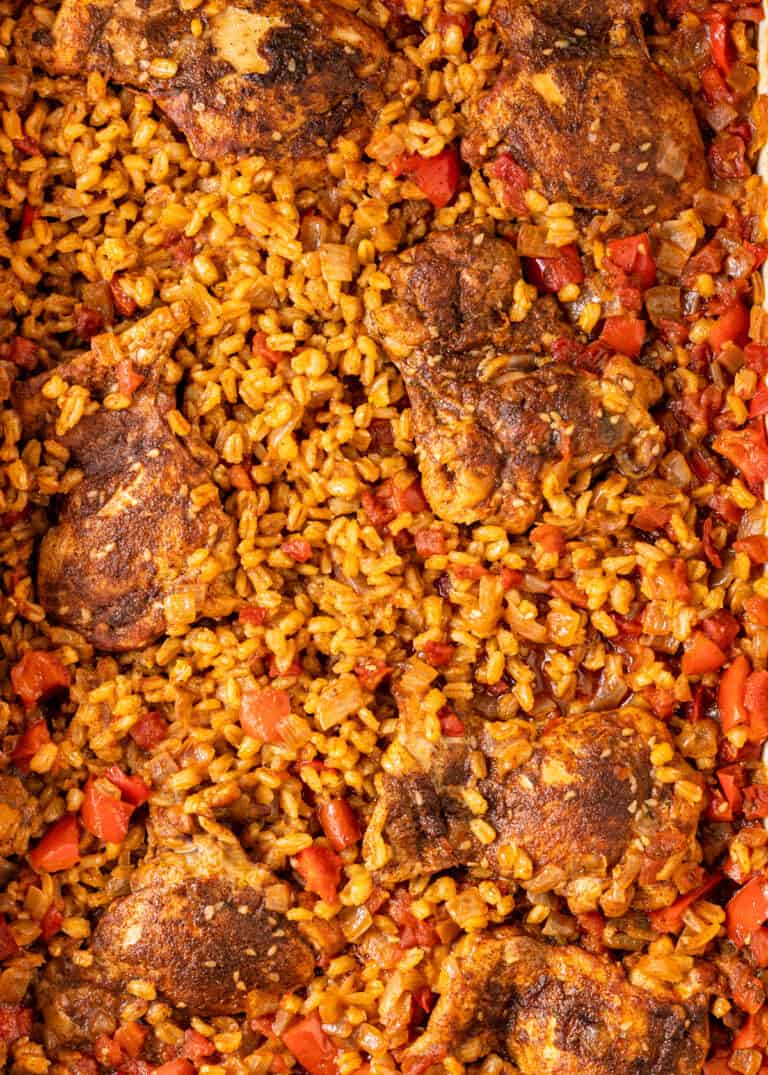 overhead image of Moroccan spiced chicken thighs nestled into grains of pearled barley