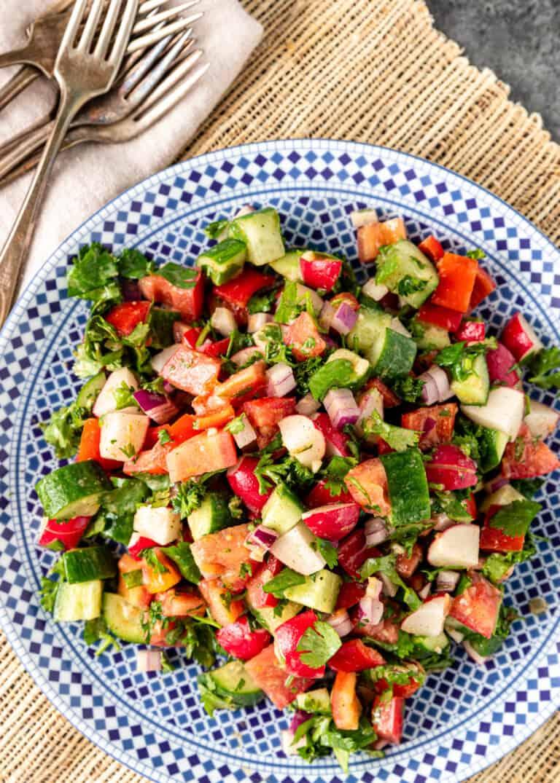 overhead: plate of chopped garden vegetables tossed in creamy lemon vinaigrette dressing