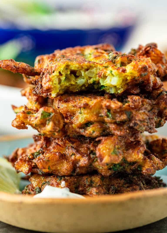 close up: stack of 4 fried cauliflower patties