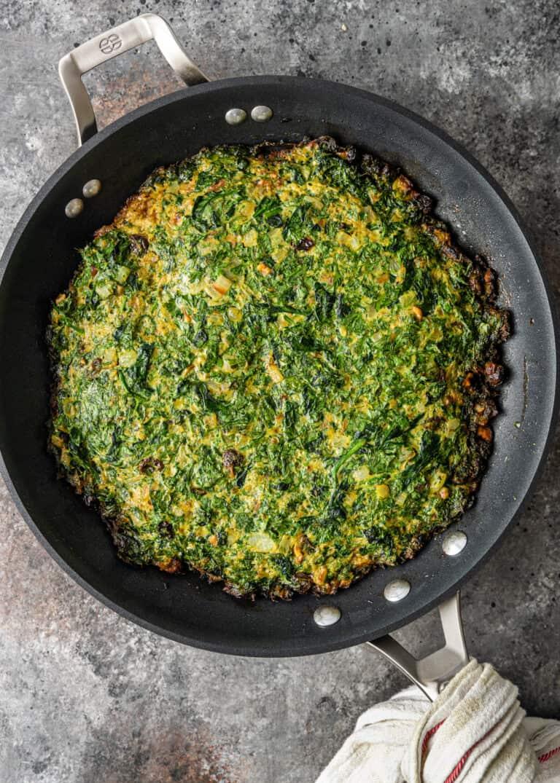 kookoo sabzi cooked in a pan