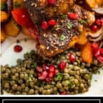 pomegranate arils on roast chicken thighs with green lentils