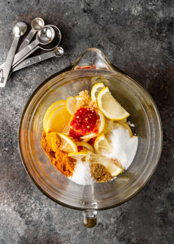 ingredients for pickling lemons in glass mixing bowl