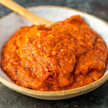 Serbian ajvar relish in white bowl with serving spoon