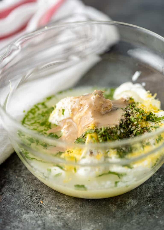 ingredients in a bowl to make tahini yogurt dressing