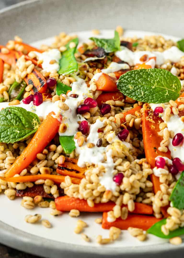 Mediterranean barley salad with grilled carrots pomegranate arils and creamy white dressing